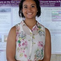 Nicola standing with her research poster