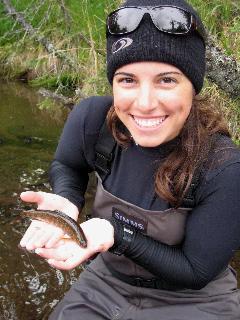 Bianca holding fish in Alaska