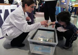 Karin demonstrating rain with a student