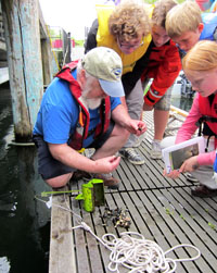 Mick working with students on the dock