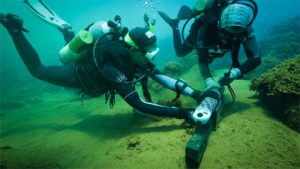 Divers working under the sea