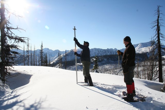Researchers measuring snow at Harts Pass
