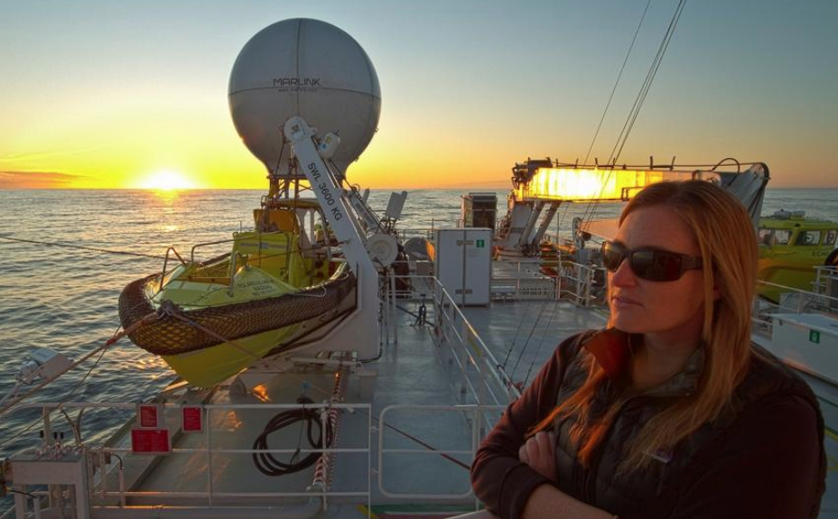 Heather on boat at sunset