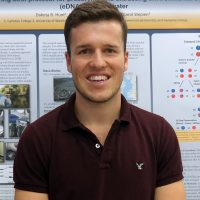 Dakota with his research poster