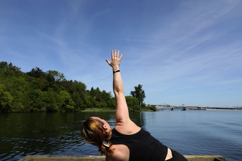 Person doing yoga near Lake Washington
