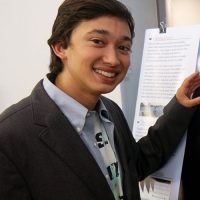 Raymond with his research poster