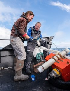 Manolo preparing to drop sensors in the water