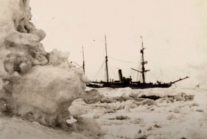 Historic photo of ship surrounded by sea ice.