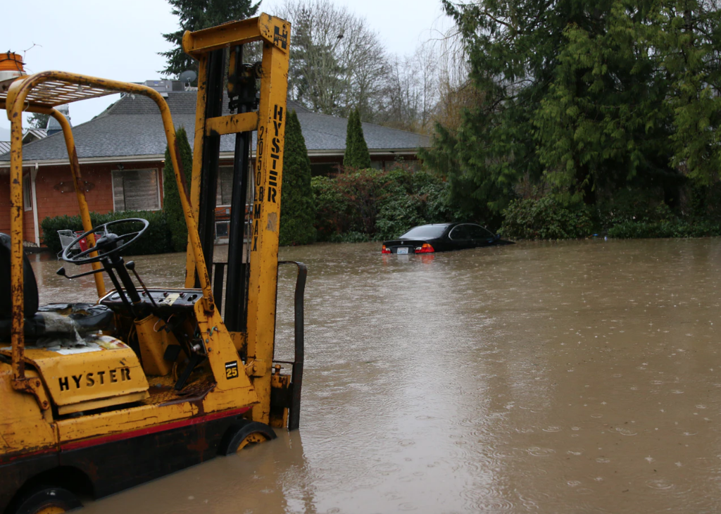 Forklift and car in deep water