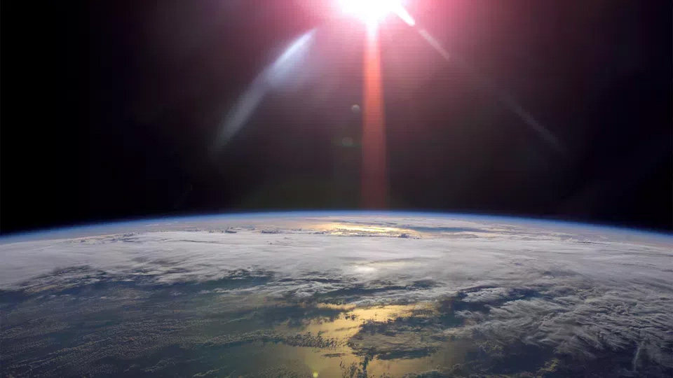 Sun over Earth from space