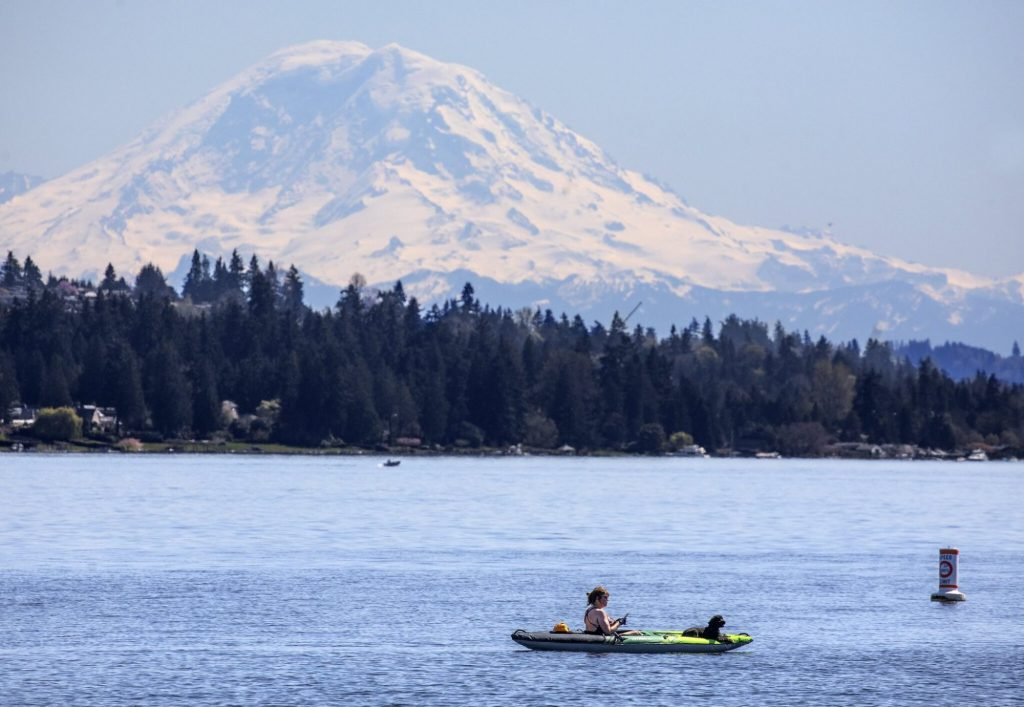 Kayaker with Mt Rainier in the background